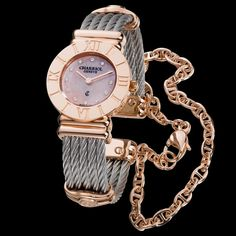 Charriol St-Tropez - Lady watch Pink gold plated steel case, 4 engraved Roman numerals on bezel, quartz movement, pink mother-of-pearl dial with 12 similis, stainless steel cables with pink gold plated metal chain and decors. Case dimensions (W) * (H) Philippe Charriol, Fashion Accessories, Fashion Jewelry, Beautiful Watches, I Love Jewelry, Metal Chain, Gold Watch, Jewelry Stores, Bracelet Watch