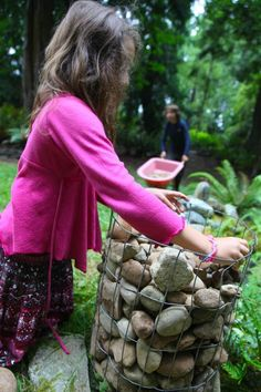 By Liesl Clark We simply have too many rocks in our soil. When we harvest potatoes, there are many false alarms on harvest day as perfect potato-shaped rocks are procured from the soil rather than… Rock Planters, Harvest Day, Gabion Baskets, Stone Pillars, Back Garden Design, Diy Fence, Garden Fencing, Garden Gate, Back Gardens