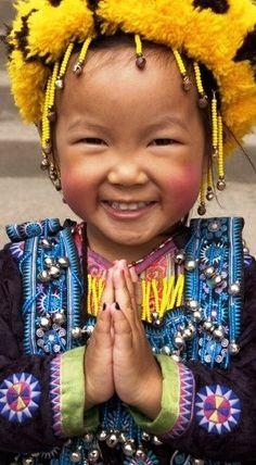 Little girl from Tibet, grinnin' like a fool!