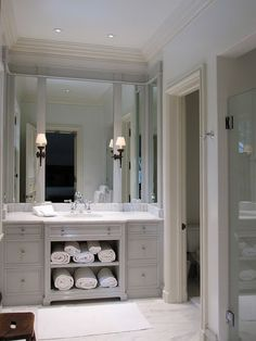 We like the idea of towel storage in a #bathroom as spacious as this one! www.remodelworks.com