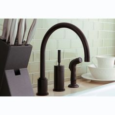 This is pretty minimal. Kitchen Faucet With Sprayer, Kitchen Faucets, Oil Rubbed Bronze Faucet, Kingston Brass, Kitchen Handles, Brass Material, Kitchen Art, Bronze Finish, Contemporary Style