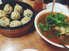 The perfect combo: momos and Tibetan noodle soup (thukpa) from Lhasa Fast Food aka the tiny Tibetan spot in the back of the Tibetan Mobile cell phone store. really knows the meaning of multi-purpose. (at Lhasa Fast Food) Queens Food, Queens Nyc, Cell Phone Store, Jackson Heights, Lhasa, Noodle Soup, Noodles, Purpose, Ethnic Recipes