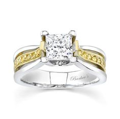 Engagement Ring With Yellow Diamonds - 7125LYDW - This two-tone white and yellow gold stunning diamond engagement ring is prong set with a princess cut center,  befitting the princess who wears it.  The white gold split shank sports a yellow gold  bridge rising from the shank, magnificently embellished with pave-set fancy yellow diamonds.  A milgrain finish adds the final touch to this stunning piece.    Also available in rose/white gold, 18k T.T., all White gold, 18k, and Platinum.