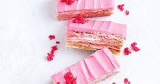 We've brought you some crazy slices over the years, from the multi-layer unicorn jelly cheesecake to the new vibrant pink Red Skins version of a classic vanilla slice. Here are a few of our favourite recipes. No Bake Slices, Coconut Slice, Chocolate Slice, Tea Snacks, Pink Food Coloring, Buttery Biscuits, Pink Icing, Red Skin, Pink Foods