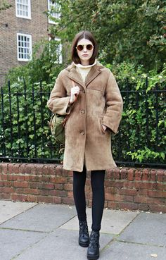 round sunglasses & fuzzy coat #style #fashion