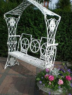 If you look closely its made out of three Singer treadle bases. the sides make the arch, the foot plate the bench seat and the fly wheel the back rest