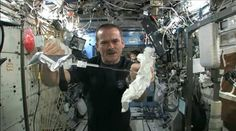 What happens when you wring a wet towel in space?