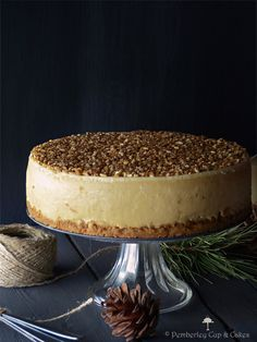 """the best cheesecake de turrón; graham crust; a rich and super creamy perfect cheesecake batter with turron; topped with a sour cream topped with caramelized almonds and honey; turrón"""" is a type of spanish sweet, much like french nougat"""