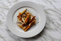 If you're tired of boring roasted potatoes, switch things up with one of the easiest rutabaga #recipes out there, all you need is olive oil, salt, garlic, thyme and a mixture of your favorite root #vegetables. Mix your rutabaga with turnips or sweet potatoes for some variety. http://www.organicauthority.com/one-of-the-easiest-rutabaga-recipes-ever-roasted-rutabaga-with-garlic-and-thyme/