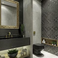 I'm a lover of black in interior. This powder room is so elegant and striking especially with the black toilet and vanity combined with the gold framed mirror and the limestone clad walls and the feature wallpaper. Bad Inspiration, Bathroom Inspiration, Bathroom Design Small, Modern Bathroom, Bathroom Black, Vanity Bathroom, Master Bathroom, Black Toilet, Guest Toilet