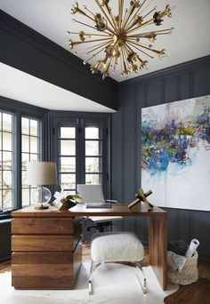 Home Office with with dark gray paint, art and brass chandelier Home Office Transitional by Amy Kartheiser Design