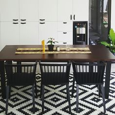 Small black and white dining. #leatherhandles #anthurium