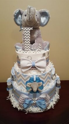 Grey and blue elephant diaper cake, It's a boy! Baby shower centerpiece gift. check out my Facebook page Simply Showers for more pics and orders.