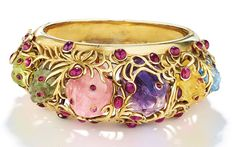 A multi-gem and gold bracelet by Jean Schlumberger. Modern Jewelry, Jewelry Art, Jewelry Design, Jewellery, Peridot, Amethyst, Italian Fashion Designers, Tiffany Jewelry, Diamond Bangle