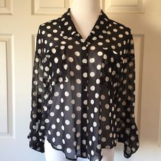 """FREE PEOPLE BUTTON UP BLOUSE Sheer Free People button up High/Low blouse. Black and off white. Size XS. Our mannequin is a 4-6 for reference. 36"""" bust 21"""" length in the front and 27 inches in the back. Roll the sleeve and button for a 3/4 look or button at the wrist. In wonderful condition. No trades. Pay Your Way- Poshmark now accepts Apple Pay, PayPal, and Android Pay. Thank you for visiting us @treaduresbytrac 💕😄💕 First photo by Free People Free People Tops Button Down Shirts"""