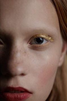 Gold leaf makes this eye makeup look truly striking.
