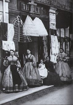 I love the way the layers seem to be displayed, the frame, then petticoat and the final result standing below on the street!