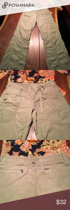 Athleta size 0 linen pants Worn maybe twice , very roomy Athleta linen pants size 0 but could fit small , maybe medium.  Has drawstring inside to tighten or loosen after eating too much!  Offers great details:  front pocket for cell phone, two roomy front pockets, drawstring at bottom to create desired affect.  Plus, two zippered pockets in back!  Truly a relaxing pant Athleta Pants Wide Leg
