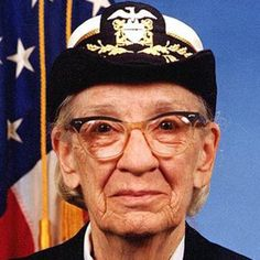 Computer programmer Grace Hopper helped develop a compiler that was a precursor to the widely used COBOL language and became a rear admiral in the U.S. Navy.