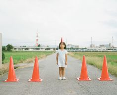 Traffic cones girl by Toyokazu, via Flickr