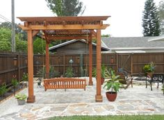 Fresh Outdoor Wood Patio Kits Under Teak Arbor Pergolas also Garden Swing Bench 2 Seater with Small Brass Chain and A Pair of Large Terracotta Bowl Planter Pots from Backyard Patio Ideas