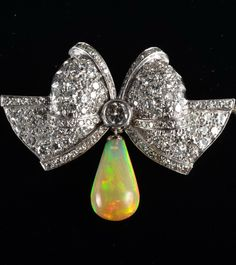 Platinum dimaond bow with opal drop brooch. dia approx. 3ct 1.50 inches x 1.96 inches, 17.2 grams