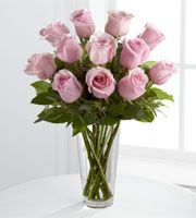 The FTD® Pink Rose Bouquet is a graceful expression of blushing beauty to convey your deepest sympathies for their loss. Our finest pastel pink roses are perfectly accented with seeded eucalyptus and arranged in a clear glass vase to create a soft sentiment of cheerful wishes that will bring comfort and warmth during this trying time.
