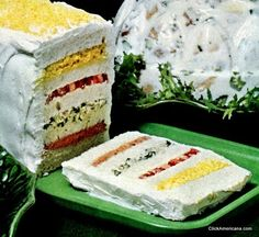 This frosted sandwich loaf holds a surprise in every layer: curried egg salad, tomato, chicken salad, and deviled ham-pickle filling between slices of bread — frosted with a velvety smooth mixture of mayonnaise or salad dressing and cream cheese. Loaf Recipes, Sandwich Recipes, Appetizer Recipes, Cooking Recipes, Appetizers, Tee Sandwiches, Egg Salad Sandwiches, Retro Recipes, Vintage Recipes