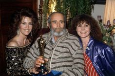 """March 29, 1982 - Henry Fonda won the Best Actor of 1981 Oscar for this role in """"On Golden Pond"""".  He was too ill to attend the ceremony.  The Oscar was accepted by his daughter Jane Fonda.  Fonda posed for photos later that evening when it was brought to his home.  He passed away that same year in August. In the photo are his daughterJane, Henry Fonda, and his wife Shirlee."""