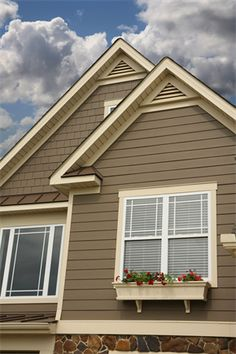 Gray exterior shake side and vertical siding for texture for Beach house siding ideas