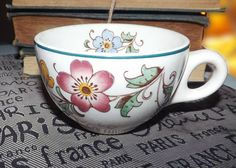 Quite vintage (c.1930s) Wood & Sons Florida pattern Vitrified Ivory hotel ware tea cup. Made for Cassidy's in Canada. Art deco florals