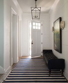 a narrow entry hall can be given the illusion of being wider, by placing a horizontal striped rug there OR if laying hardwood, install the boards across the are, rather than lengthwise.