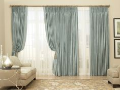 These beautiful, pleated drapes are made with 100% Dupioni silk (ADO fabric design 1218) and paired with pinch pleated voile sheers (ADO fabric design 3000) for a dramatic, elegant look.