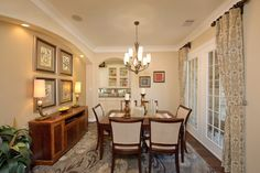 An arched doorway leads from the dining room to a Butler's Pantry. The Florence plan built by Chesmar Homes at Greatwood Lake in Richmond, Texas is featured on NewHomeSource.TV.