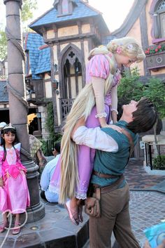 Rapunzel and Flynn love - That little girl in the corner is EXPLODING with wonder. Can I just be a Disney Princess now?! Please?