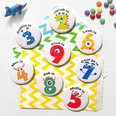 """Our monster birthday badge is not only adorable its the perfect addition to any birthday party!  Whether you are having a monster birthday party or you just think they are cute, your little birthday boy or girl will love it. Each button badge is metal backed to please be careful when gifting this to any child to put on (pins are sharp!)  Each monster badge is 58mm (approx 2 1/4"""") and comes with a colourfully fun monster on the front along with """"YOUR CHILD'S NAME is"""" above each number."""