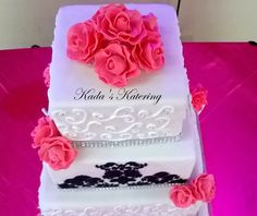 Damask themed wedding cake with pink flowers