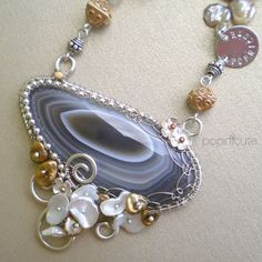 Popnicute Artisan Jewelry specializes in wire wrapped metal sheet jewelry made of Argentium silver, copper, and brass. Order your custom made jewelry today! Agate Jewelry, Metal Jewelry, Jewelry Necklaces, Jewellery, Pearl Necklace, Pendant Necklace, Wire Work, Artisan Jewelry, Fashion Necklace
