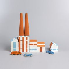 Prototype set of painted wooden building blocks and toy cars and trucks: 20 rectangular blocks, 19 wedge-shaped blocks, 4 cone-shaped blocks, 9 cars/trucks. Blocks painted with various combinations of rectilinear forms in white, light blue, and orange. Vehicles painted in various combinations of orange, blue, and gray; one red and white car.