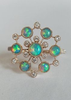 For Sale on - Dalben design Opal ring with 7 Australian Opals and 22 white round brillant cut Diamonds weighing carats mounted in 18 kt warm white gold. Gold Diamond Rings, Opal Rings, Diamond Cuts, Gold Rings, Opal Jewelry, Nice Jewelry, Jewellery Box, Jewlery, October Birth Stone