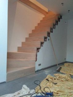 in 2020 Stairs In Living Room, Living Room Interior, Interior Desing, Interior Decorating, Stair Renovation, Wood Cladding, Loft House, Under Stairs, Wood Shelves