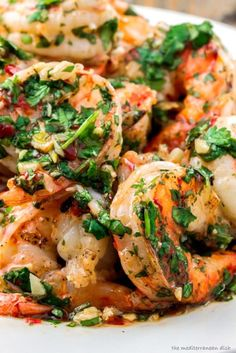 Grilled Shrimp w/ Roasted Garlic Cilantro Sauce. This grilled shrimp recipe with roasted garlic-cilantro sauce is an impressive appetizer! Charred prawns dressed in slightly spicy, robust flavors. Grilled Shrimp Recipes, Fish Recipes, Seafood Recipes, Dinner Recipes, Cooking Recipes, Healthy Recipes, Grilled Prawns, Grilling Recipes, Healthy Meals
