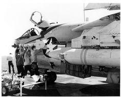 "Ordnancemen load an AIM-9 Sidewinder onto a LTV A-7E ""Corsair II"" on the flight deck of the USS NIMITZ (CVN-68) operating in the Indian Ocean, 1980. via Robert Sullivan flickr"