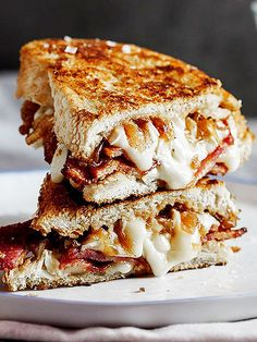 12 Yummy Recipes for Extreme Carb-Loading | BACON & BRIE GRILLED CHEESE | There's never a bad time for grilled cheese, especially when it involves salty bacon and creamy Brie like this recipe from Simply Delicious.