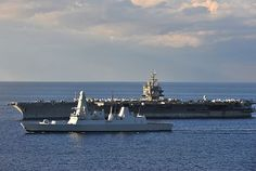 The aircraft carrier USS Enterprise (CVN 65) iunderway with the Royal Navy Type 45 destroyer HMS Daring (D-32) in 2010.