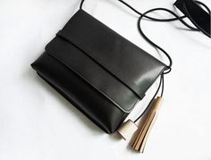 Simple Black Leather Crossbody bag with wood and leather tassel wholesale whole sale
