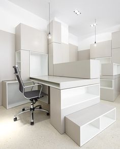 Walls, shelves and desks are all made from piles of modular blocks at this office in Paris by French studio h2o Architectes