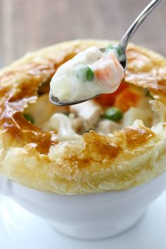 Homemade Chicken Pot Pie has the most delicious homemade, creamy filling with an easy puff pastry crust. A family favorite for generations!