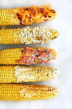 GRILLED CORN-ON-THE-COB 4 ears corn 6 cups cold water Kitchen twine, for securing 1. Pull corn husks to stalk end without removing them. Remove any silks, then return the husks to their place and t...
