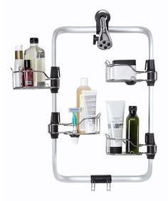 "Organizing bathroom accessories is a breeze with this clever storage solution. Each of the four shelves includes a removable insert that keeps toothbrushes, small bottles and more upright, while the rust-proof frame ensure a sparkling finish. Plus, it attaches firmly to the wall thanks to a sturdy suction cup. Frame: 14.5'' W x 23.25'' HShelf: 3.25"" W x 5'' HMetal / silicone / plasticImported"
